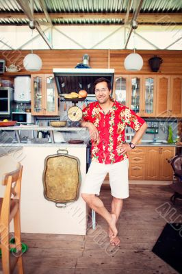 Artistic lifestyle photo of adult friendly man at his kitchen at