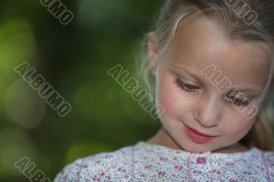 little blonde girl watching down look amused