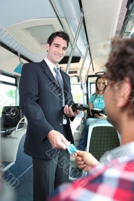 conductor checking tickets on a tram