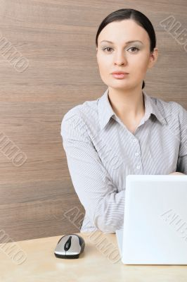 Portrait of a beautiful young businesswoman working  on the comp