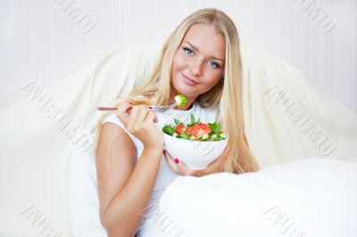 Closeup portrait of a beautiful slender girl eating healthy food