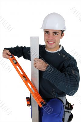 Worker with level spirit on white background