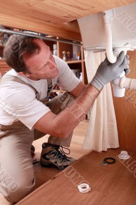 Labourer fixing sink