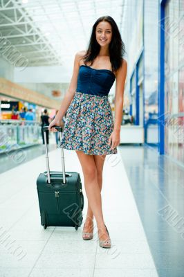 Young woman with luggage at the international