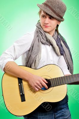 Closeup portrait of cute caucasian man playing the guitar over g