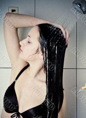 Beautiful young woman take shower