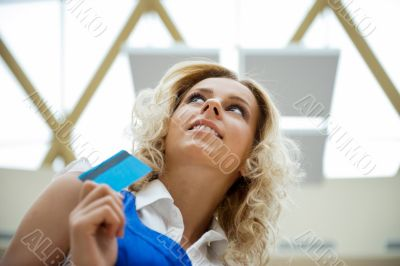 Beautiful shopping woman holding a credit card
