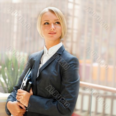 Portrait of a cute business woman with her laptop inside office