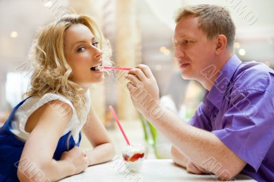 Closeup portrait of young cute couple at mall cafe. Man proposin