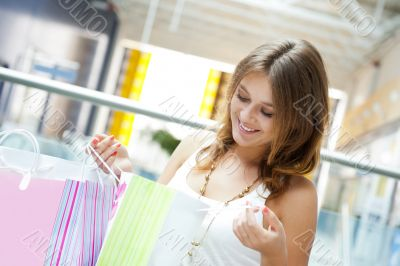 Happy shopping woman with bags and smiling. She </sp
