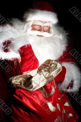 Santa sitting at the Christmas room and looki