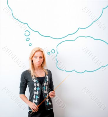 Portrait of young teacher pointing on white marker board in mode