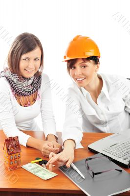 Portrait of two young women discussing construction project.
