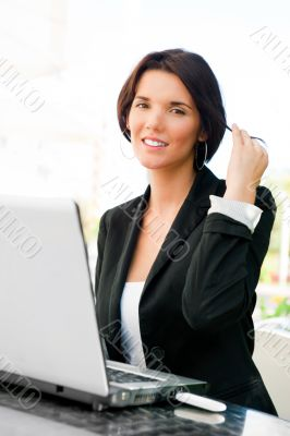 Young business woman on a laptop using wireless internet connect