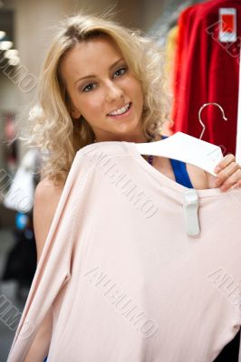 Pretty woman shopping clothes