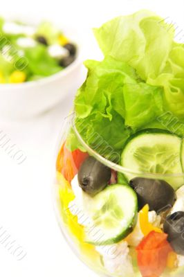 Closeup studio shot of fresh salad in glass