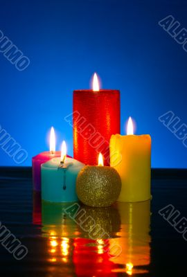 Five burning colourful candles