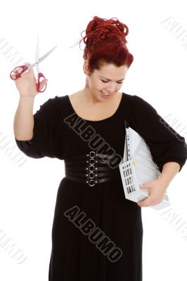 Modern girl with scissors and folder of documents