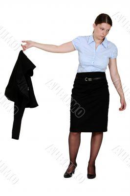 Frumpy businesswoman taking off her blazer