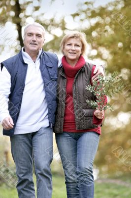 Couple taking a walk through woodland
