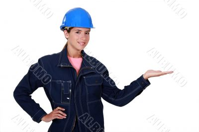 Manual worker holding out her hand in empty copyspace