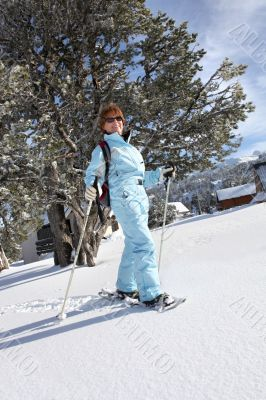 a mature woman doing snow board
