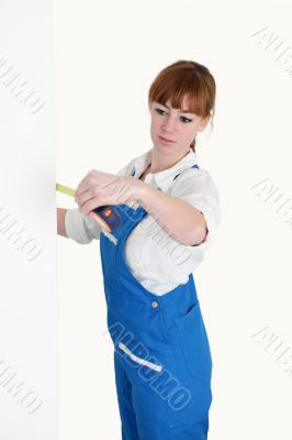 Female worker with a tape measure