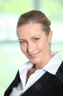 Head and shoulders of a smiling female executive