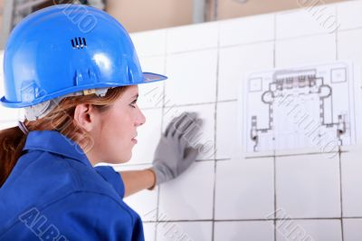 Woman foreman consulting plan