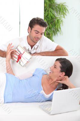 Boyfriend offering gift to girl