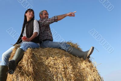 portrait of a couple on a hay bale