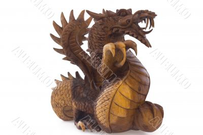 Wooden dragon, symbol of chinese new year, isolated on white background