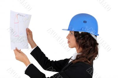 An engineer inspecting drawing