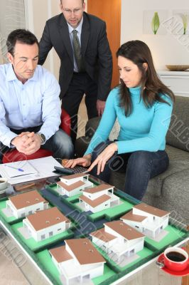 Couple calculating the cost of their new home