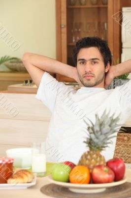 Man relaxing in kitchen