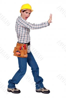 Woman pushing against an imaginary wall