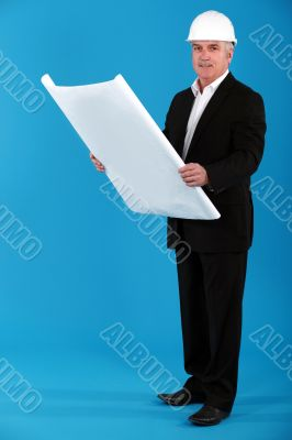 Architect standing on blue background
