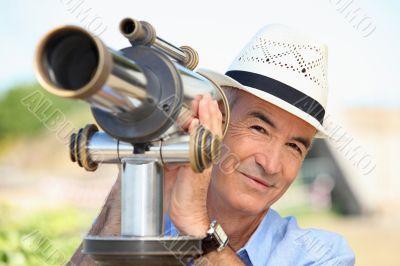 senior watching through a telescope