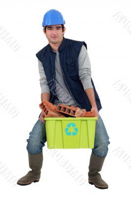 Man recycling bricks