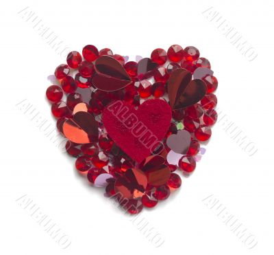Heart shape made with confetti and crystals,  isolated on white
