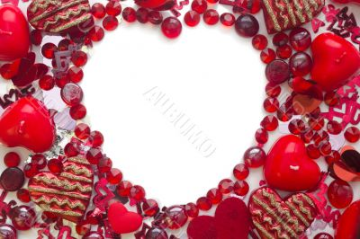 Shape of heart made with confetti and crystals,  isolated on white