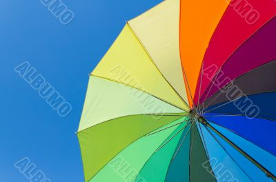 Colorful umbrella on a sky background