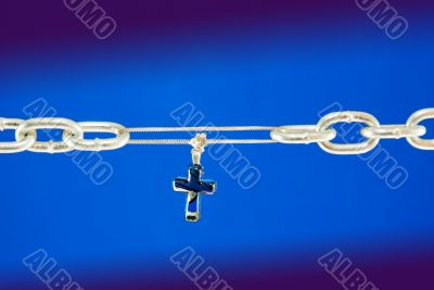 Broken chain connected with a cross