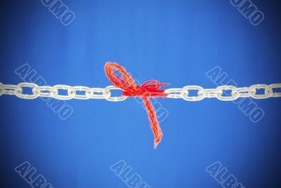 Broken chain connected with red threads