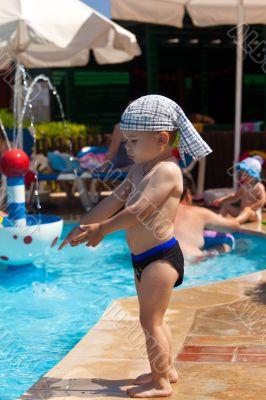 The little boy at children pool