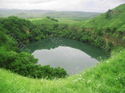 Small lake between the caucasus mountains summertime