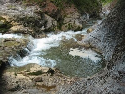 Waterfall between the rocks. North Caucas nature