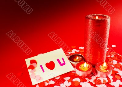 St. Valentine`s day greeting background with four burning candle