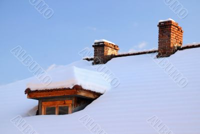 Attic Window and Two Chimneys in Winter