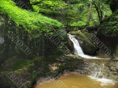 Waterfall between the rocks. The Caucasus nature